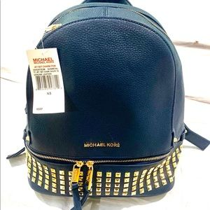 New with tags. Blue Michael Kors book bag.